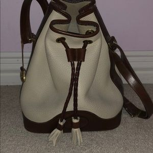 Dooney & Bourke, cream medium-size drawstring bag